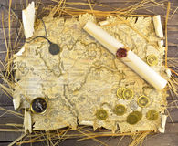 Pirate map of treasures. Pirate map with paper scroll, medallion and golden coins royalty free stock image