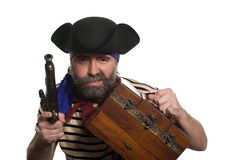 Pirate with a musket holding chest. Isolated on white Stock Images