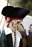 Pirate no more. The skull and bones of a 'dead pirate ' with period hat and clothes hanguing by a rope Royalty Free Stock Photo