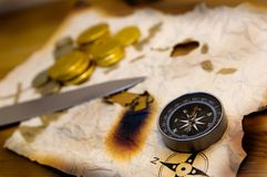 Pirate Objects. An old map, compass and gold doubloons belonging to a pirate Royalty Free Stock Photos