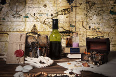 Pirate objects with map on the backgrond. Pirate objects, pirates booty, pirate still life, chest with a antique jewelry, knot letter with sealing wax on the Stock Photo