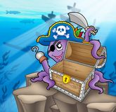 Pirate octopus with chest in sea Royalty Free Stock Image