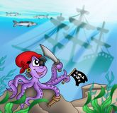 Pirate octopus near ship underwater Royalty Free Stock Images