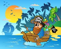 Pirate paddling in boat near island Stock Photos