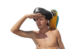 Pirate with a parrot. On his shoulder looking into the distance Royalty Free Stock Photos
