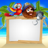 Pirate and parrot beach sign. Cartoon pirate beach sign illustration of a fun cartoon pirate with his parrot pointing over a sign on a beach Royalty Free Stock Photo