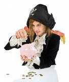 Pirate and piggybank. A pirate holding a piggybank isolated on white Royalty Free Stock Image