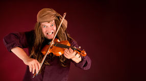 Pirate Playing Violin to Announce Something. Pirate Playing Violin and Announcing Something on a banner with copy space Royalty Free Stock Photo