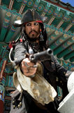Pirate Raid. Pirate Captain points his pistol during a raid royalty free stock photo
