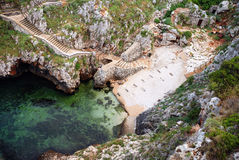 Pirate's cove... A small cove inside the rocky coast of southern italy Stock Photography