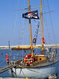 Pirate sail boat. Anchored to dock stock photo