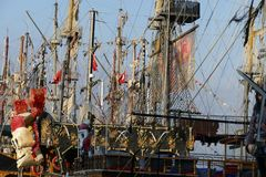 Pirate sail vessel. Masts and rigging on a pirate sail vessel with Turkish flags on blue sky background Stock Photos