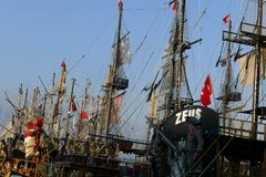 Pirate sail vessel. Masts and rigging on a pirate sail vessel with Turkish flags on blue sky background Royalty Free Stock Images