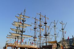 Pirate sail vessel. Masts and rigging on a pirate sail vessel with Turkish flags on blue sky background Stock Photo