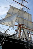 Pirate Ship. An old time pirate ship with full sails at dock Royalty Free Stock Photo