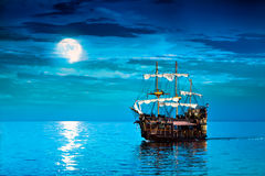 Pirates ship. Pirate ship, Flying Dutchman ghost ship sailing under the moon. Another Jolly Roger voyage Royalty Free Stock Photography