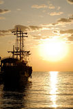 Pirate Ship. Pirates ship in the sea at sunrise Stock Photos