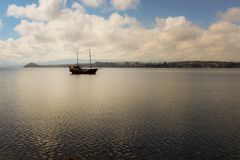 Pirate ship. Calm in the bay with some clouds in the sky royalty free stock photo