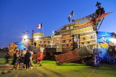Pirate ship attraction at a summer carnival, photographed at night royalty free stock photography