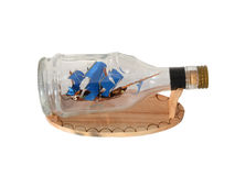 Pirate Ship in a Bottle. Pirate Ship in Bottle on white background Stock Photo