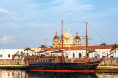 Pirate Ship and Church View. View of an old style pirate ship with San Pedro Claver Church in the historic old city center in Cartagena, Colombia Royalty Free Stock Images