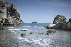 Pirate ship from cove Stock Images