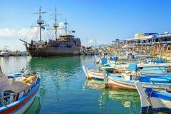 Pirate ship and fishing boats in harbor of Ayia Napa. Stock Photos