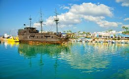 Pirate ship and fishing boats in harbor of Ayia Napa. Stock Photography