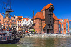 Pirate ship and historic port crane at Motlawa river Stock Photos