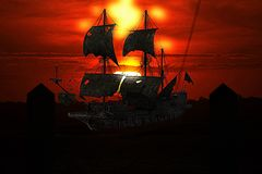 A pirate ship lays at anchor in a mystical Caribbean harbor-town royalty free stock image