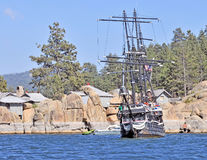 Pirate Ship. The old pirate ship is leaving Kidd Cove on a warm summer afternoon with a full complement of crew and passengers Stock Photo