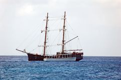 Pirate ship replica at sea. Reenactment of pirate battle in the Cayman Islands Stock Images