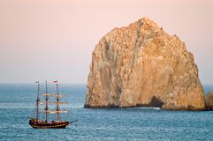 Pirate Ship and Rock. A pirate ship on a sunset excursion Royalty Free Stock Photography