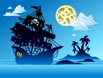 Pirate ship silhouette with island Stock Image