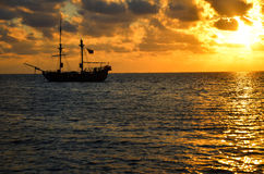 Pirate Ship Sunrise. Orange sunrise with pirate ship on Caribbean Sea in San Andres, Colombia Royalty Free Stock Photos