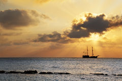 Pirate ship at sunset Stock Photos