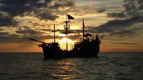 Pirate ship at sunset stock footage