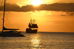 Pirate Ship Sunset. Pirate ship and Catamaran in the sunset in Rodney Bay, St. Lucia Royalty Free Stock Photography