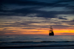 Pirate ship in sunset scenery. Royalty Free Stock Images