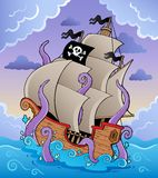 Pirate ship with tentacles in storm. Vector illustration Stock Photos