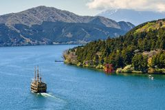 Pirate ship and Torii gate, Hakone. Hakone, Japan - May 4, 2017: Top view landscape of pirate tourist ship on Ashi lake to sightseeing red  torii gate  of Hakone Stock Image