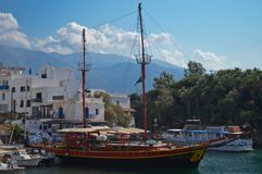Pirate ship for tourists in a bay in Krete, Greece. A pirate ship in Sisi village bay in Krete, Greece with high mountains in the background Royalty Free Stock Image