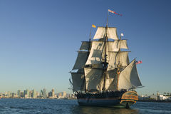 Pirate Ship under Sail. Tall Sailing Ship with shoreline in the background Royalty Free Stock Photo