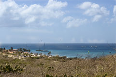 Pirate ships moored off of Malmok Beach on Aruba`s NorthWest coast. Multiple boats lie at anchor in the azure waters off Malmok Beach, Aruba Stock Photography