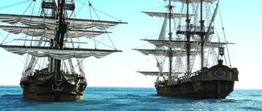 Pirate ships positioned close to each other out to sea. Royalty Free Stock Photography