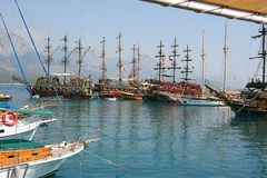 Pirate ships at the shore against the background of mountains. royalty free stock image