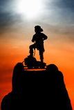 Pirate silhouette. Silhouette of a pirate standing on a small rock shelf Stock Images