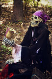 Pirate. A skeletal pirate holding a golden goblet with jewelry.  Taken at Boo at the Zoo at the Milwaukee County Zoo for Halloween Royalty Free Stock Photography