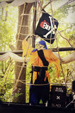 Pirate. A skeletal pirate on a pirate ship with a can of black gun powder.  He is wearing orange, black and blue.  Taken at Boo at the Zoo at the Milwaukee Stock Images