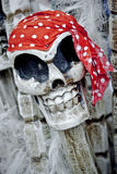 Pirate skelton, halloween image. Quirky image of a model skull and a bright bandana Royalty Free Stock Images